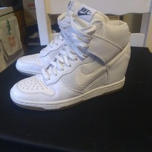Women's White Nike Dunk Sky High Mesh wedge shoes.